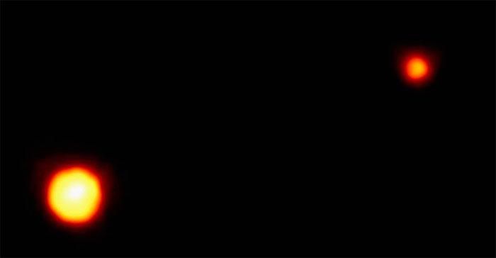 Foto do Telescópio Hubble de Plutão e Caronte