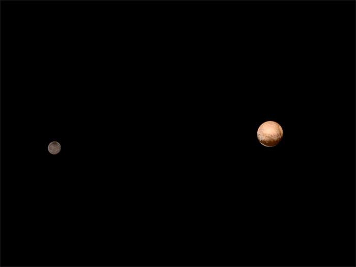 Imagem linda de plutão junto com sua lua Caronte - foto